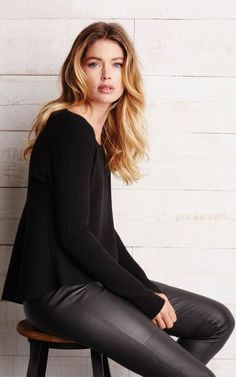 Doutzen Kores in a rib knit pullover and leather pants by REPEAT