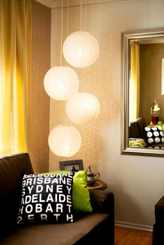 Capital Cities cushion on sofa, and a glimpse of the World Clocks cushion in the mirror