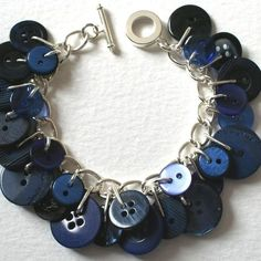 This charm bracelet is a great use for grandmother's old buttons. I think a necklace would be nice!