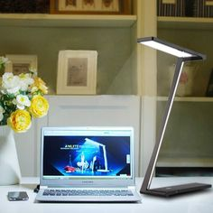 """Floureon LED Table Light with Ultra Thin Foldable Aluminum Design to act as the """"best friend"""" of the darkness . No flickering for eyes-caring.  Amazon.co.uk: Electronics"""