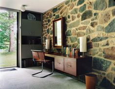 This refurbished 1959 home, designed by Breuer, features some of Breuer's original built-in furniture, including the desk in the bedroom. The chair was also designed by the architect.