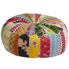 It's the global version of your grandmother's crazy quilt. Instead of raiding her supply of remnants, Indian artisans have used textiles and sari fabrics to create a colorful, cotton patchwork cover for our comfy pouf. Grandma might not have been so crazy after all.