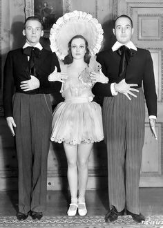 "Douglas Fairbanks, Jr., Joan Crawford, and William Haines strike a comic pose while attending a Marion Davies ""baby doll"" party, 1932"