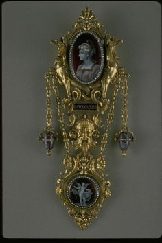 Chatelaine    Created by,  Alphonse Fouquet  Paul Grandhomme enameller  Charles Beranger enameller Sèvres  , 1878  Materials and techniques:  Chased gold, enamel painted on nacdre, rose-cut diamonds.