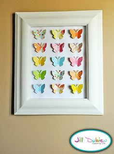 Not butterflies, or those colors...but pick different shapes and coordinate for the boys' rooms?