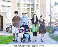 Stock Photo - Father walking with his biracial children outdoors. Disabled son in wheelchair has cerebral palsy. - stock image, images, royalty free photo, stock photos, stock photograph, stock photographs, picture, pictures, graphic, graphics