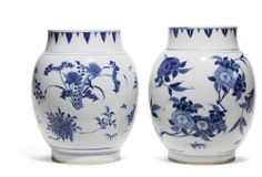 Lot 192 | Sotheby's THE JULIAN THOMPSON STUDY COLLECTION TWO BLUE AND WHITE 'SEED POD' JARS CIRCA 1640 each body of ovoid form rising from a short straight foot to a short straight neck, painted around the exterior with floral sprays Quantity: 2 26cm., 10 1/4in.