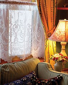Lace Curtain Store | Discount Heritage Lace curtains and textiles.  I know lace layered under drapery panels is old fashioned but I love it!  Very cozy and pretty!