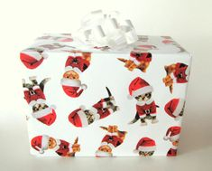 Kittens in Santa Suits Christmas Wrapping Paper, Holiday Gift Wrap 10 ft x 2 ft. / 3.048 m. x .60 m. Roll, Sweet little kittens dressed in Santa suits decorate this paper with a white background. A fun paper for kids and cat lovers. Ready to ship a mailing tube just for this paper! It will be shipped separate from other items in most orders.  Follow this link for our selection of Holiday Wrapping paper: https://www.etsy.com/shop/CMWrapNShipSupply/items?search_query=christmas+gift+wrap+roll…