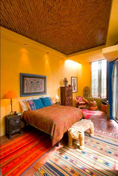 Great colors - I love the ceiling and the gold walls, and the ethnic textiles are awesome.