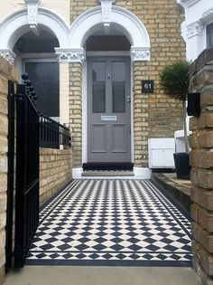 london front door with victorian black and white mosaic tile path and new brick…