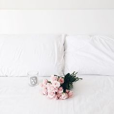 White bed with roses