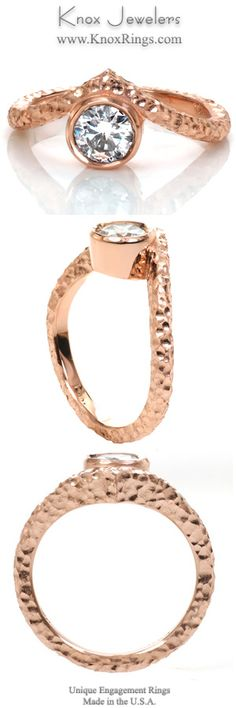 This bezel set unique engagement ring has a contemporary look with a hammered finish on the rose gold band.