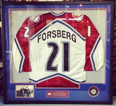 The holidays are right around the corner, folks! A custom framed jersey is the perfect gift for a sports fan! But don't wait! These are time consuming to frame and time is running out! Get yours in today! Custom framed Peter Forsberg Avalanche jersey includes conservation glass, puck, photo and reversible stitching. Property of JJ Lane. Custom framed by FastFrame of LoDo! #art #framing #denver #colorado #avalanche #forsberg #jersey