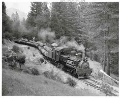 West Side Lumber log train West Side Lumber Co. three-truck Shay No. 8 eases a log train downhill east of Tuolumne, Calif. The picturesque 3-foot-gauge logging line shut down in 1960.