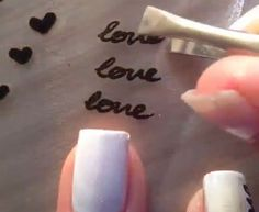Write in Permanent marker on a piece of plastic then put clear nail polish over the top. Once this has dried, peal off and stick on to nail.