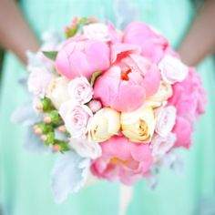 Lush pink and yellow roses and coral peonies made up the bridesmaid bouquets.