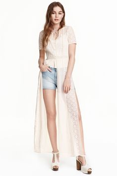 Full-length chiffon blouse: Full-length blouse in airy chiffon and lace with short sleeves, buttons at the top and high slits in the sides.
