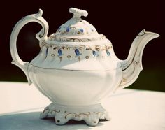 This charming vintage teapot is so vintage that it has no mark stamped on the bottom.  This means that it probably predates the use of marks and is late-nineteenth century.