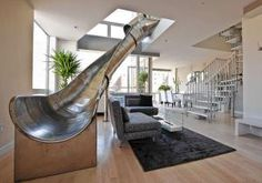 Stairs are optional in this Manhattan duplex penthouse.  The kid in you would love giant metal slide to use every day!