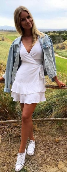 #winter #outfits white v-neck mini dress and blue denim jacket outfit. Pic by @kookai_australia.