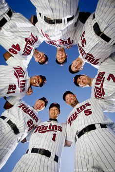 Minnesota Twins huddle and pose for a picture at Spring Training March 2, 2011 at Hammond Stadium in Fort Myers, Florida.