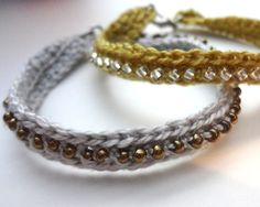 Crochet seed bead bracelets. I can see these as a great way to use those small bits of yarn and beads that are floating in my craft supplies.
