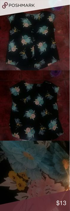 Torrid Floral Blouse Sz 1 Cute button up shirt size 1 or equivalent to size 14. Black with flowers. Great pre-owned condition. 100% polyester. Torrid Tops Blouses