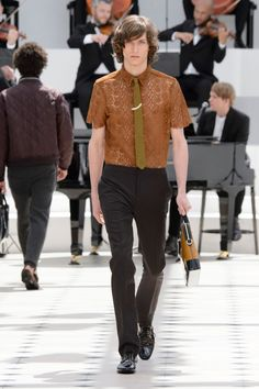 Burberry Prorsum Spring/Summer 2016: The focal point of Burberry Prorsum's latest outing is simple and sweet–lace. Christopher Bailey used the luxe and unlikely material to transform dress shirts and ties.