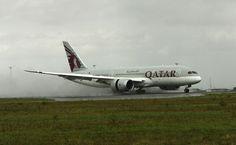 Qatar Airways Boeing 787-8 Dreamliner making a damp arrival at Copenhagen, Denmark