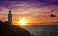 Sunset behind a lighthouse. Beautiful