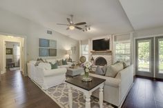 Benjamin Moore Revere Pewter walls with White Dove ceilings and trim in open concept floor plan.