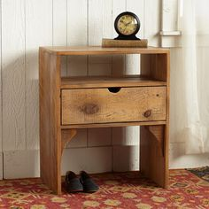 """PLYMOUTH FARMHOUSE NIGHTSTAND--Wood salvaged from a vintage Wisconsin dairy barn is fashioned into a handsome nightstand with classic lines. A lightly weathered patina, brought on by years of use, brings out the beauty and character of each pine plank. USA. Ships from our supplier in 2 to 4 weeks. Additional shipping, $75. 23""""L x 23""""D x 28""""H."""