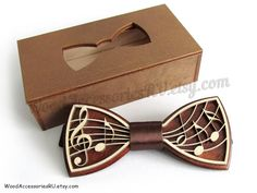 Wooden two-layered bow tie Music   - exclusive design  - adjustable strap  - eco materials used  Dimensions of the bow tie: 110 х 50 mm (4.33 x 1.96 inches) Dimensions of the gift box: 120 х 60 х 22 mm (4.72 x 2.36 x 0.86 inches)  Shipping time: no less than 2 weeks (and no less than 3 weeks to Germany or Spain due to some unknown customs issues)  A great and creative present for any musician