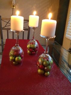 upside down wine glasses with ornaments and candle.  imagine how cute it would look with margarita and martini glasses, as well.