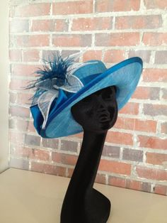 Kitty Mae Millinery created this right pretty hat!  Love it!  http://t.co/gQAq7kfL
