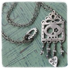 Sugar Skull Papel Picado Fine Silver and Sterling Silver necklace by 2SilverTrees on Etsy https://www.etsy.com/listing/215309059/sugar-skull-papel-picado-fine-silver-and