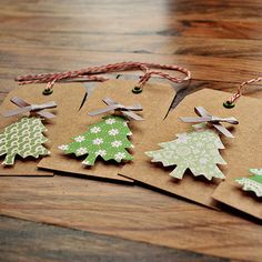 Christmas gift tags...trees (could cut out of scrapbook paper or cardstock), popped up and topped with bows.