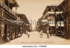 Port Said, Egypt - 1910 - A postcard shot of Commerce Street, a multi-cultural city, at the mouth of the Suez Canal on the Mediterranean Sea, whose existence and fortunes coincided with the building of the Suez Canal in 1869.COPYRIGHT PHOTOGRAPHIC COLLECTION OF BARRY IVERSON - Stock Image