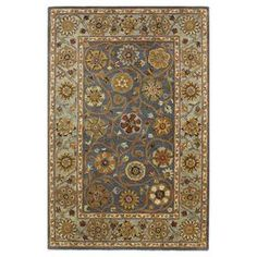 Hand-tufted wool rug in denim blue with a multicolored floral motif.   Product: RugConstruction Material: 100% WoolColor: DenimFeatures: Hand-tuftedNote: Please be aware that actual colors may vary from those shown on your screen. Accent rugs may also not show the entire pattern that the corresponding area rugs have.Cleaning and Care: Regular vacuuming and spot cleaning recommended
