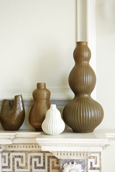 Jonathan Adler - The Relief Pottery Collection. Mix patterns, hues, and sizes on an empty shelf.