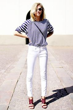 Browse the best summer street style outfit ideas at @stylecaster | 'The Fashion Eaters' blogger in contrast-stripe tee, white skinny jeans, red sandals