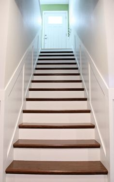 How to add tread and new risers to a staircase - stair kit from Home Depot, Minwax Wood Stain in American Walnut, Minwax Polyurethane, glossy white paint on riser panels