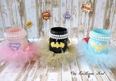 This listing includes: 3 pint size centerpieces  -1 superman (super girl) -1 wonder woman -1 batman (batgirl) All 3 pieces include a tutu,cape