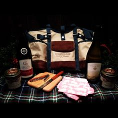 Michigan Picnic Tote: Perfect for the homesick Midwestern or oenophile in your life, the Michigan Picnic Tote features two bottles of Michigan wine, cheese knife and cutting board, wine opener, and two Brownwood Farms preserves, packaged in a Toasted Oak tote for $75.