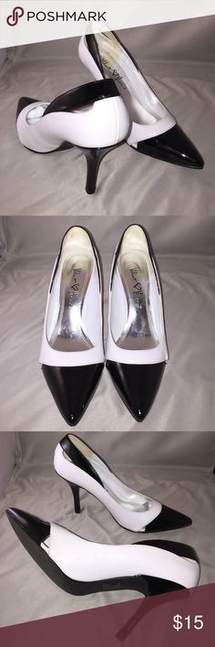 Velvet Heart black and white pumps sz 8M VELVET HEART black and white pumps in size 8M. Stylish cut outs in toe box and heels. Perfect for work. Worn twice and in perfect condition Velvet Heart Shoes Heels