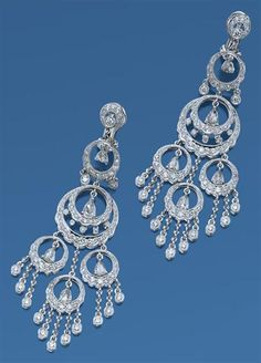 Pair of Diamond Pendant-Earrings   18 kt. white gold, the chandelier style earrings designed as 5 diamond-set circles, each accented by a flexibly-set pear-shaped rose-cut diamond and collet-set diamond fringe, totaling 10 pear-shaped rose-cut and 210 round diamonds approximately 2.95 cts., approximately 11 dwt.