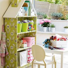 """Transform a bookcase into a doll's house: A simple bookcase can be transformed with an MDF roof and chimney, then finished with paint and wallpaper - great for creating a fairytale-style room."""