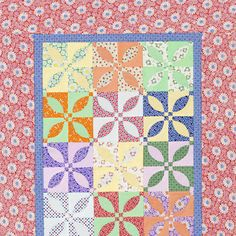 What looks like intricate curved piecing on this table runner isn't actually piecing, but rather curved appliqués layered atop an easy-to-make foundation block. Each block features a print and coordinating solid from Granny's Treasures collection by Nancy Mahoney for P Textiles.