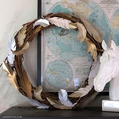 DIY Feather Glitter Wreath Tutorial from Lia Griffith (with free printable feather templates)